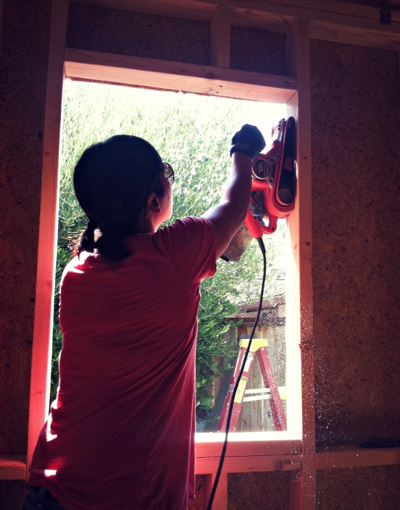 Sanding one of the windows of the great room.