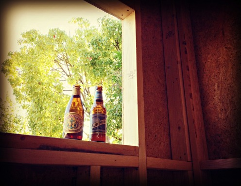 Inaugural beers in the tiny house, after a first day of work.