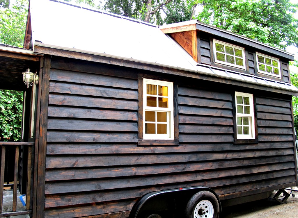 Dark exterior siding: An initial layer of espresso stain, then transparent black lacquer hand-rubbed  into the wood.