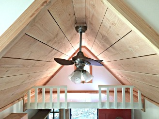 Our ceiling light fan and storage loft (above the front door).