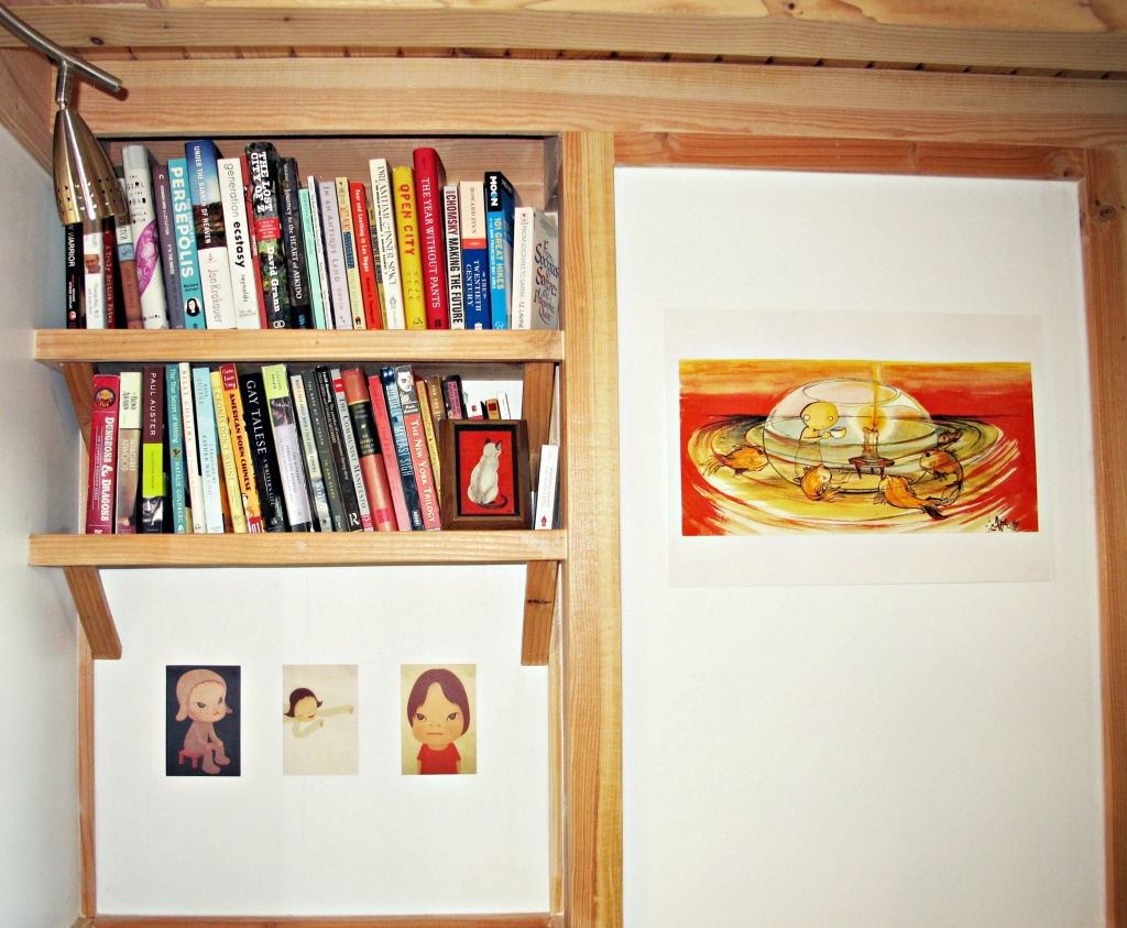 I donated hundreds and hundreds of books in the past year-and-a-half; these are the ones that made the cut. I've begun to put up some artwork collected during my travels, too.