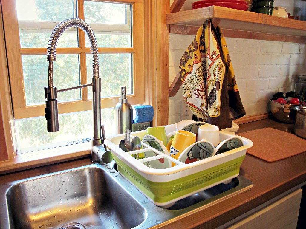 Our small kitchen sink and collapsible dish drainer (which was a good buy).