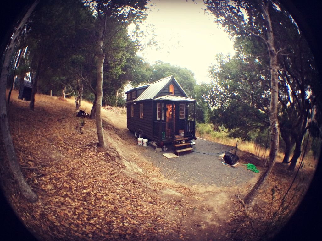A wide shot of the house and the land we're parked on, through a fisheye lens.