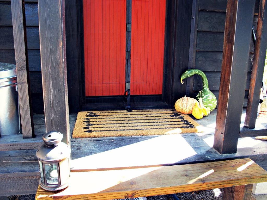 Porch essentials: mat, Magic Mesh door screen, and gourds from Hale's Apple Farm on Highway 116.